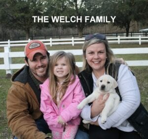 The Welch family and their dog