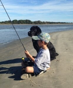A child and dog fishing