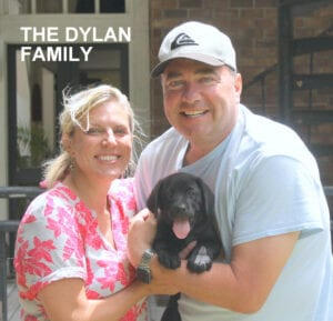 The Dylan family and their black pup