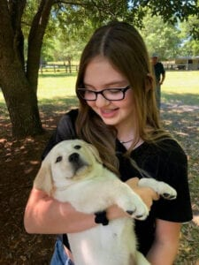 A puppy carried by a girl
