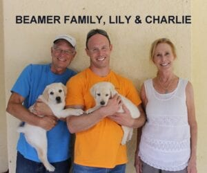The Beamer family and their puppies