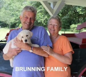 The Brunning family and their new pup