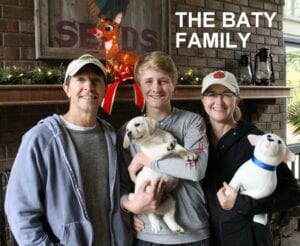 The Baty family and a pup