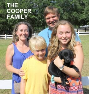 The Cooper family and their new pup