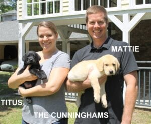 The Cunninham family and their puppies