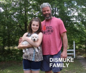 The Dismuke family and their dog