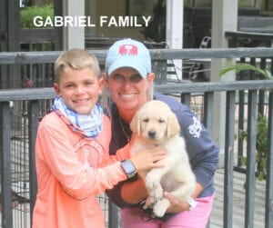 The Gabriel family and a puppy
