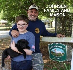 The Johnsen family and Mason