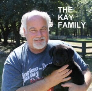 The Kay family and their new dog