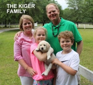 The Kiger family and their pup