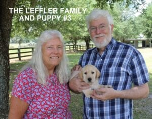 The Leffler family and puppy number three