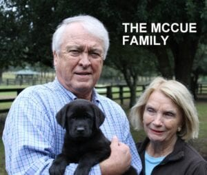 The McCue family and their pup