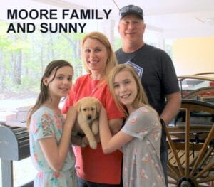 The Moore family and Sunny