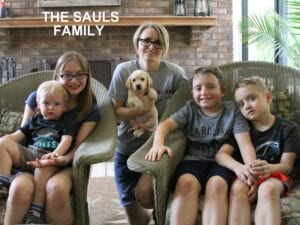 The Sauls family and their puppy