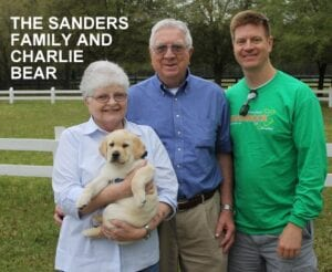 The Sanders family and Charlie Bear