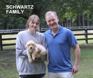 The Schwartz family and their puppy