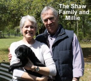The Shaw family and Millie