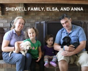 The Shewell family and their new puppies