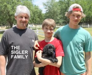 The Sigler family and their pup