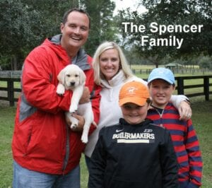 The Spencer family and their puppy