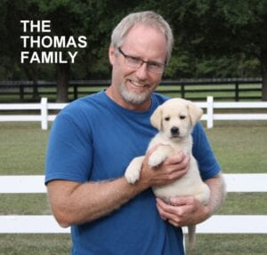 The Thomas family and their puppy