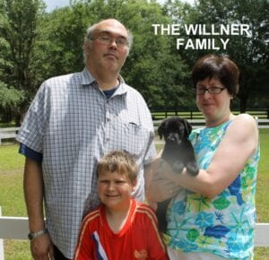 The Wilner family and their new pup