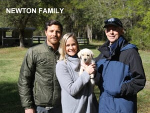 The Newton family and their pup
