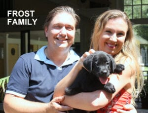 The Frost family and their black pup