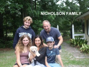 The Nicholson family and their puppy