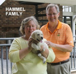 The Hammel family and their puppy