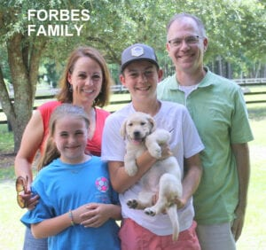 The Forbes family and their puppy