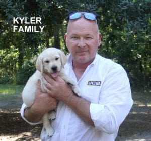 The Kyler family and their pup