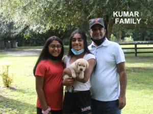 The Kumar family and their puppy