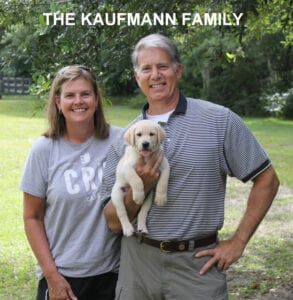 The Kauffman family and yellow pup