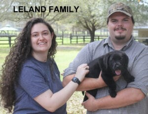The Leland family and their black pup