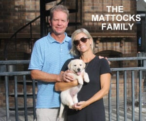 The Mattocks family and a yellow pup