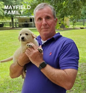 The Mayfield family and a yellow pup