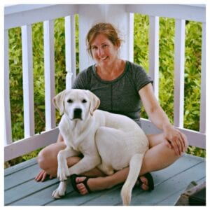 A dog sitting on a woman's la