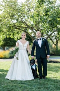 A married couple with their dog