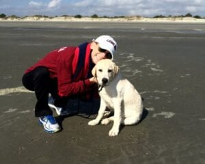 A dog with its owner at the beach
