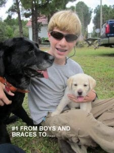 A kid with two dogs