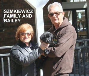 The Szmikiewicz family and bailey