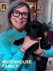 The Widenhouse family and their puppy