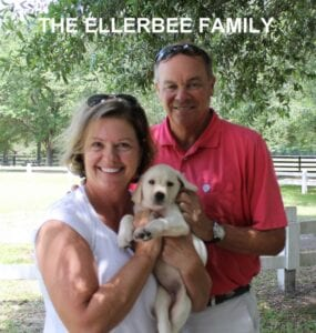 The Ellerbee family and their new pup