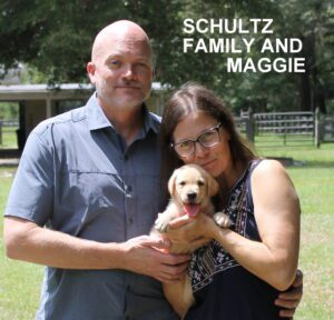 The Schultz family and Maggie